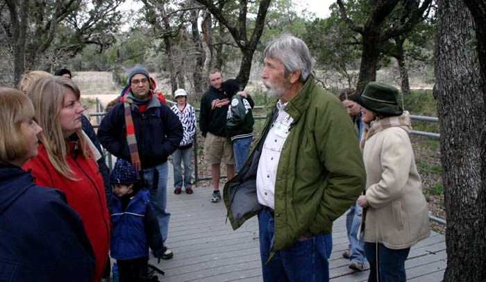 John Ahrns and the tour at theWestcave Preserve deck overlooking the Pedernales River